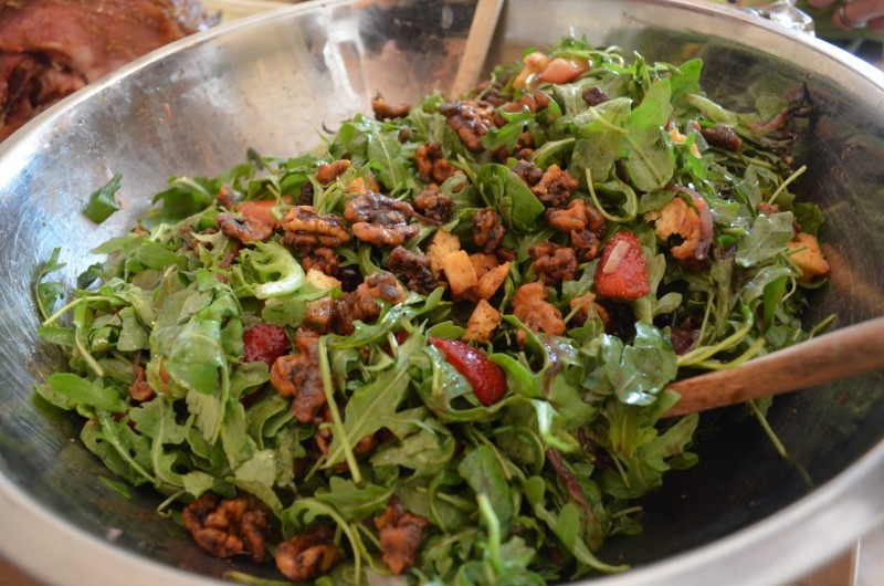 Arugula salad with candied walnuts, strawberries and maple vinaigrette